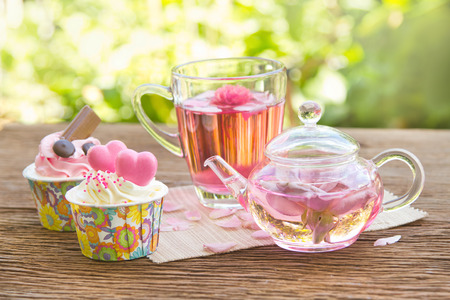Afternoon tea breake, rose tea with tea pot in the garden photo