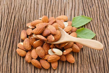 wooden scoop:  dried almonds in wooden scoop