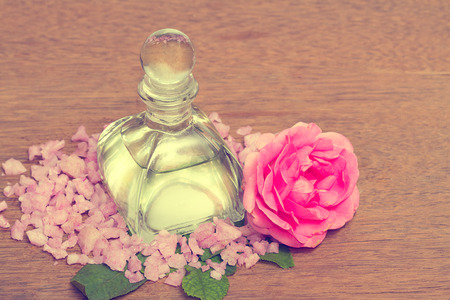 Rose essential oil in bottle, aroma oil use for spa and massage photo