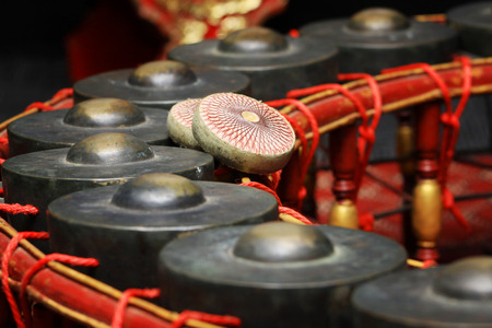 Thai musical instrument ,Gong Instrument for rhythm( select focus at drumstick ) photo