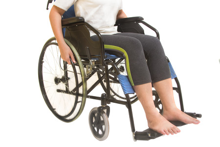 paraplegia: A disabled woman posing in a wheelchair isolated Stock Photo