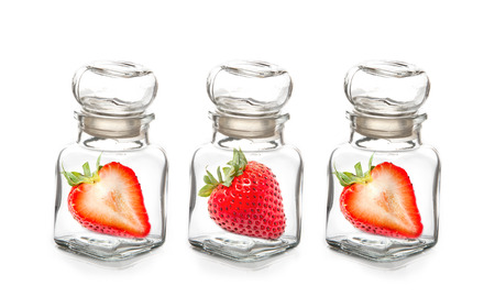 Strawberry in the  glass bottle photo
