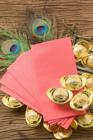 pow: Chinese new year festival decorations, ang pow or red packet and gold ingots. Stock Photo