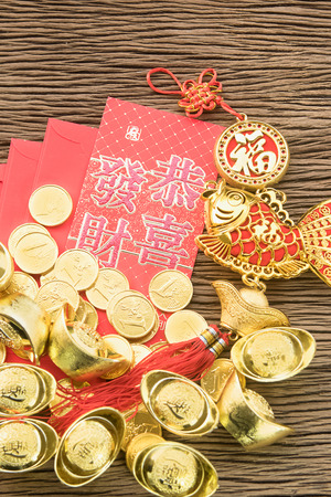 Chinese new year festival decorations, ang pow or red packet and gold ingots. photo