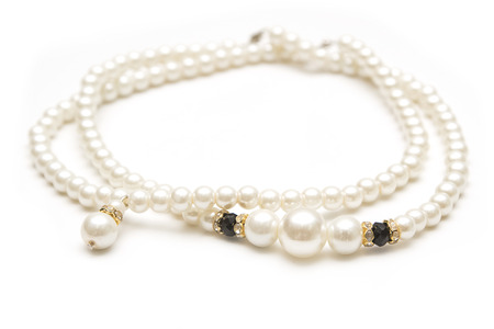 Beautiful pearl necklace on white