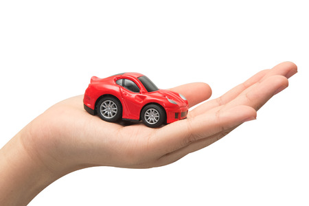 fully comprehensive: hand holding the model of car. symbol photo for car purchase