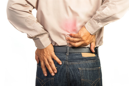 lower back pain: businessman having lower back pain,Office syndrome concept