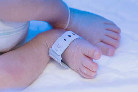 Newborn baby foot with identification hospital tag name under uv Banco de Imagens - 39786089