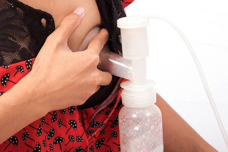 'breast milk': mother pumped breast milk from the breast. Stock Photo