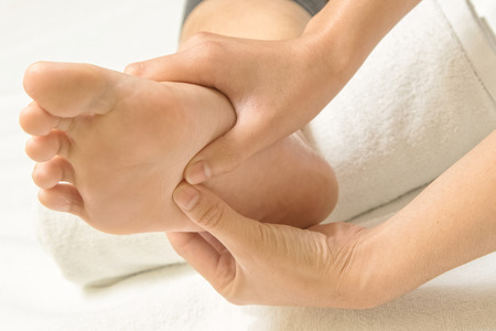 Reflexology foot massage Stock Photo