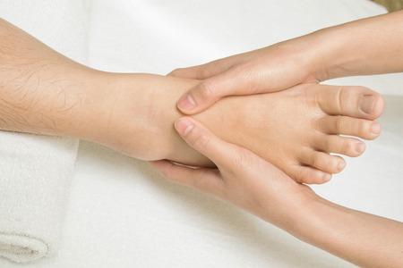 traditional healer: Reflexology foot massage Stock Photo