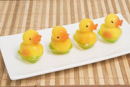 imitations: Coconut yellow duck jelly in white dish