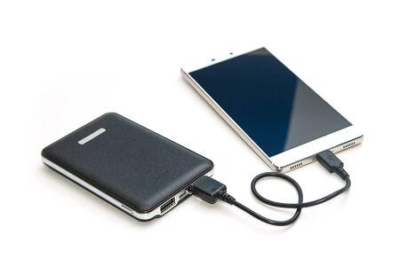 recharging: Recharging smart phone tablet from power bank Stock Photo