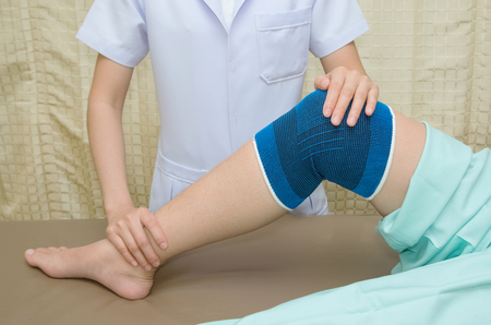 velcro: Patient  doing physical exercises with physical therapist ,  in rehabilitation clinic Stock Photo