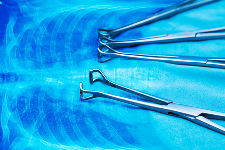 x ray equipment: medical  instruments on anatomy blue background Stock Photo