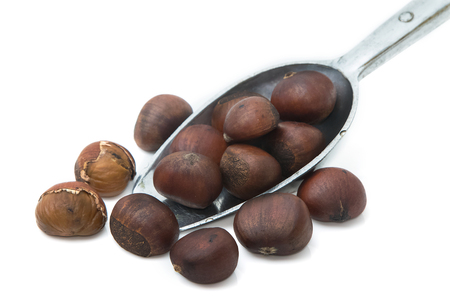 nutty: roasted chestnuts on white background