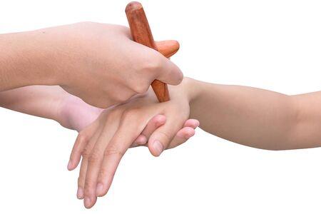 rejuvenate: Reflexology hand  massage,Thai spa massage  treatment with wood stick isolate on white with path