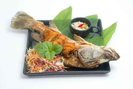 mango fish: Fired fish with fishsauce and mango salad , Thai food  favorite Stock Photo