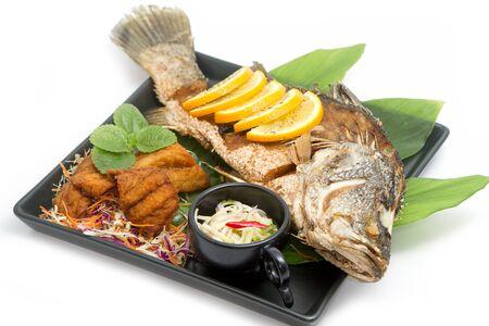 mango fish: Fired fish with fishsauce and mango salad , Thai food  favorite Stock Photo