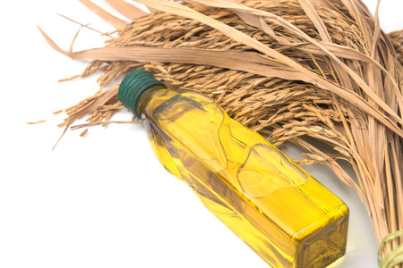 lecithin: Rice bran oil in bottle glass with rice paddy on white