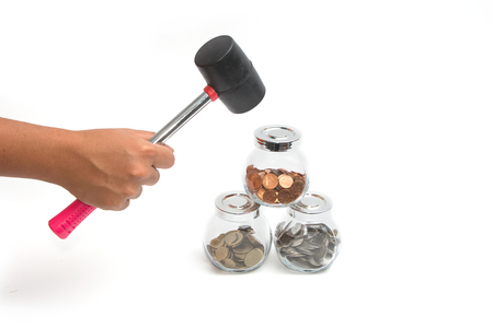 suggests: A hammer about to smash a jar of money. Suggests breaking into savings money