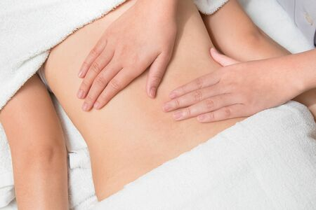 visceral: Closeup beautiful asian woman having visceral massage