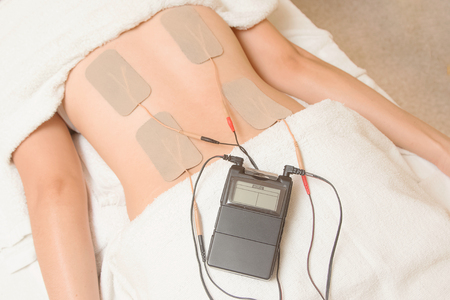 TENs therapy, Electrodes of tens device on back muscle Imagens