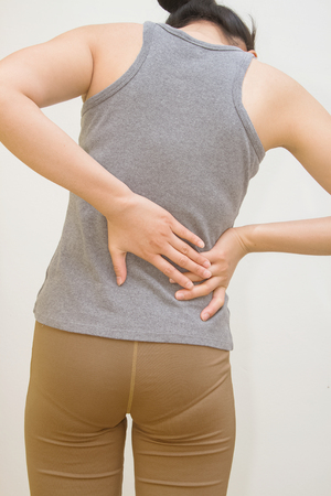 spinal disc: Attractive female person suffers from backache