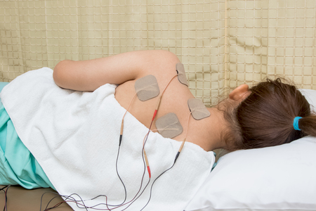 eletrical: Woman with eletrical stimulator for increase muscle strength and release pain, treatment and rehabilitation