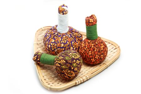 rejuvenate: Spa herbal Compressing ball on white background. Stock Photo