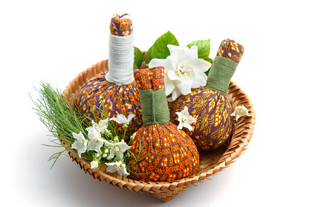 revitalize: Spa herbal Compressing ball with Thai flower on white background.