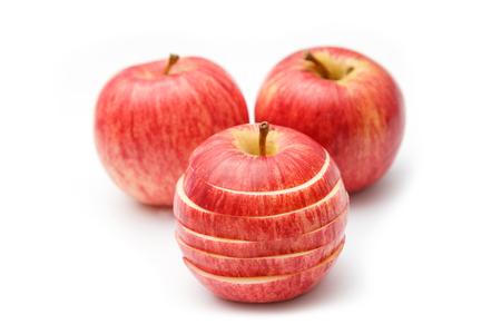 sliced apple: Sliced apple over white background