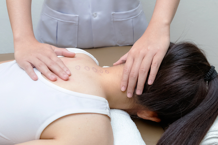 spinal adjustment: Chiropractor doing adjustment spinal spine on female patient