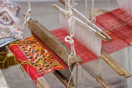 loom: Weaving loom and the silk Stock Photo