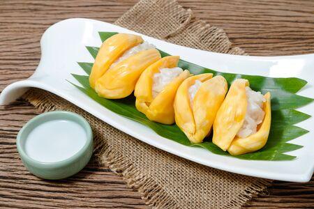 jack fruit: Thai style dessert, sticky rice in jack fruit with coconut milk Stock Photo