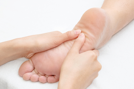 revitalize: Reflexology foot massage in the day spa Stock Photo