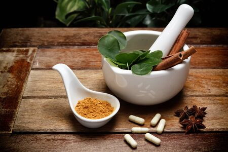 alternative health care: Alternative health care dried various herbs in wooden background