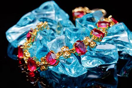 jewlery: Ruby gold bracelet isolated on black background Stock Photo