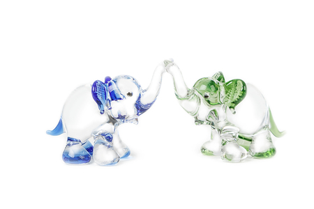 figurines: Two glass elephant figurines on white background Stock Photo