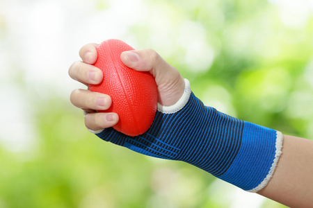 patient s woman hand squeezing a stress balls
