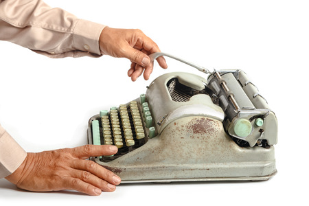 business man writing with old typewriter on white background