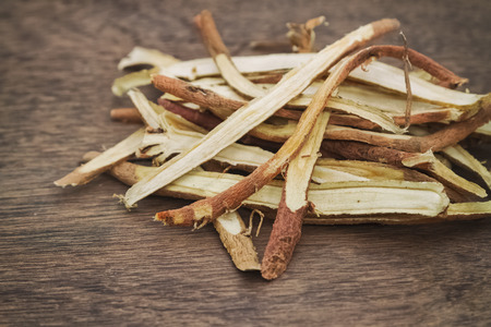 Liquorice root baked used in chinese herbal medicine Stock Photo