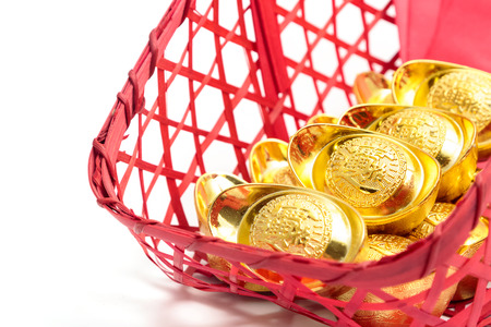 Chinese new year festival decorations, ang pow or red packet and gold ingots. Stock Photo