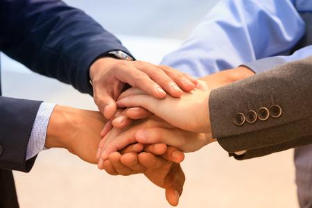 Business team joining hands together,teamwork concept.