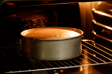 double oven: Double layer cake in hot oven ,homemade bake