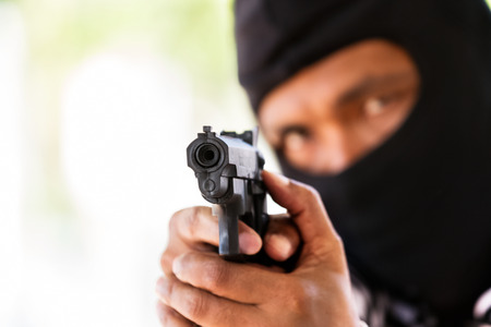 Man with gun, gangster, focus on the gun (robbery, gun, pistol) Stock Photo