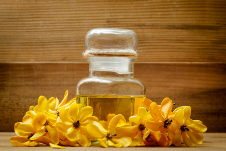 Essential oil with yellow gardenia flowers for aroma massage
