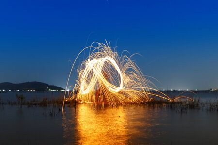 steel wool: Colorful ring of fire at the lake,Burning Steel Wool spinning