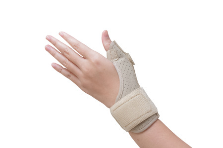 Trauma of wrist in brace.sport injury Stock Photo