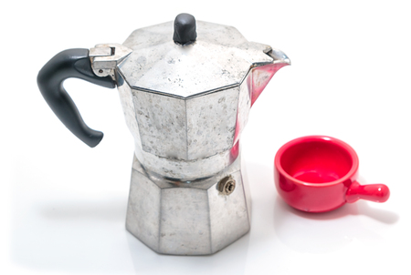 Moka coffee pot with red cup on white
